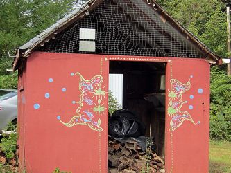 Hippie-painted outbuilding.